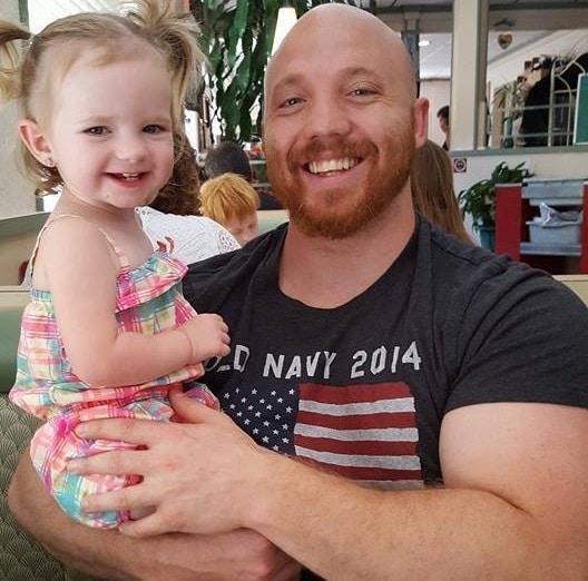 Matt Anton SEO headshot with baby